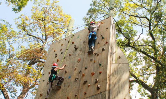 Participants on climbing wall