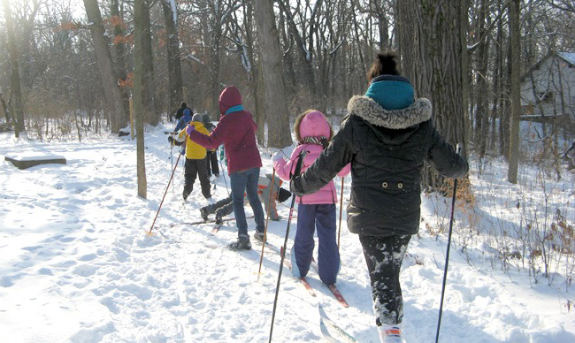 Family cross country skiing at Irons Oaks.
